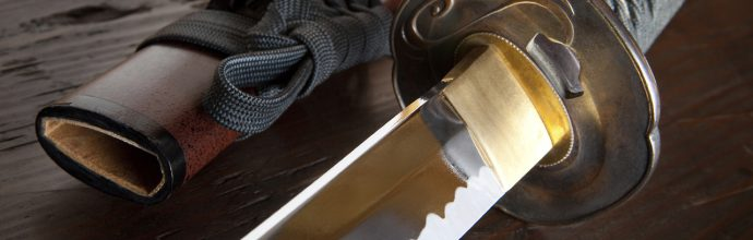 Real japanese samurai sword and sheath on wooden board