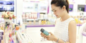 Asian woman shopping in the store cosmetics